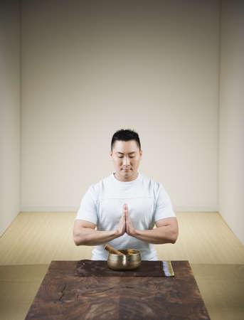 singing bowl: Praying Asian man with singing bowl LANG_EVOIMAGES