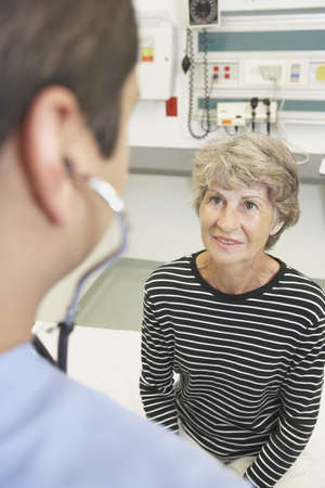 generation gap: Senior woman talking to doctor in hospital