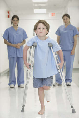 ninety's: Nurses watching boy with broken leg walk with crutches