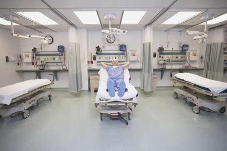 living being: Doctor sleeping in hospital bed LANG_EVOIMAGES