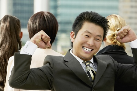 Young Asian businessman cheering