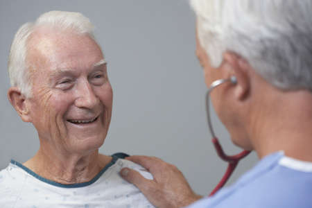 ninetys: Senior male patient being examined by doctor