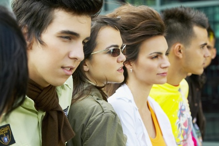 warmers: Group of Hispanic young people in a row outdoors