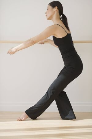relishing: Middle-aged Asian female dancer practicing