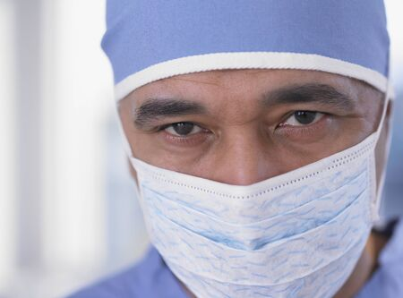 scrub cap: Close up of African male doctor with surgical mask