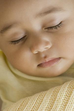 drizzling rain: Close up of Hispanic baby sleeping