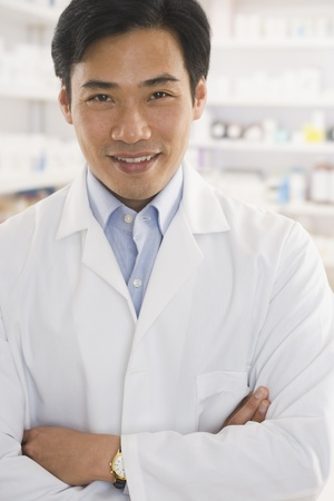 davenport: Asian male pharmacist standing in pharmacy