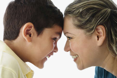 motioning: Hispanic mother and son touching foreheads