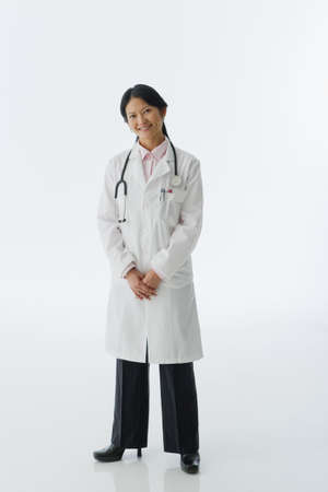 dressup: Studio shot of Asian female doctor LANG_EVOIMAGES