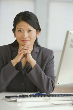 giver: Asian businesswoman sitting at desk