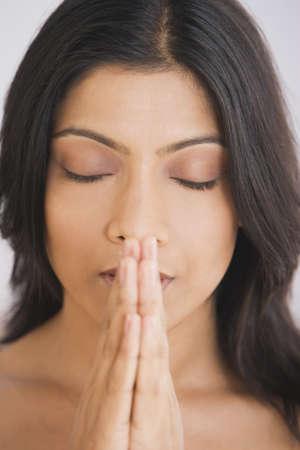 Close up of Indian woman praying