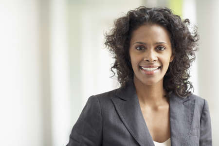 american currency: African businesswoman smiling
