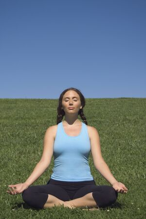 hairclip: Young woman meditating in field