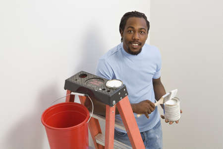 africanamerican: African man on ladder painting