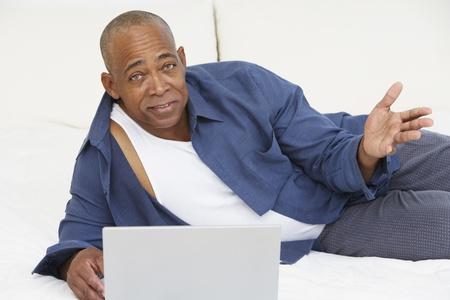 bathtowel: Senior African man with laptop