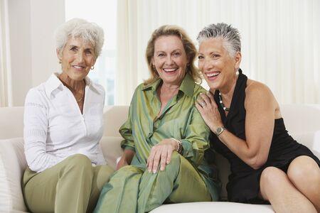 gramma: Three senior women sitting on sofa