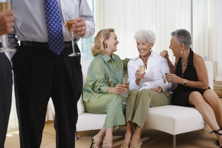 3 persons only: Three senior women talking on sofa at party LANG_EVOIMAGES