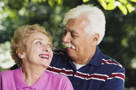 latin couple: Senior Hispanic couple smiling at each other