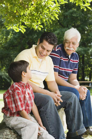 gramma: Hispanic grandfather, father and son sitting together