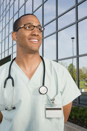 hindering: African male nurse with stethoscope