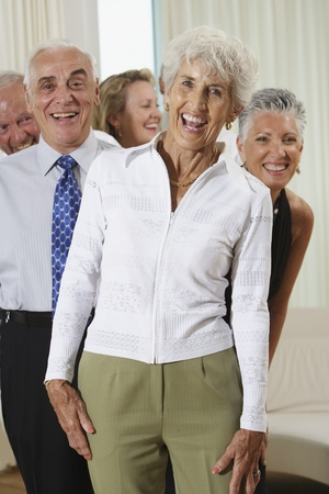 age 5: Group of seniors at party LANG_EVOIMAGES