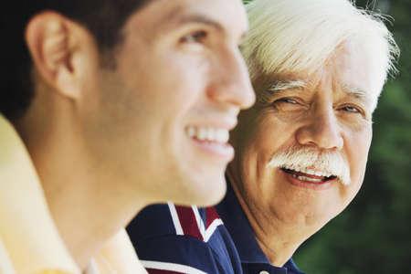 grampa: Senior Hispanic man with adult son LANG_EVOIMAGES