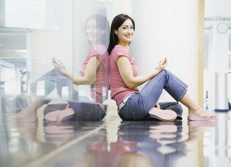 slumbering: Portrait of Hispanic woman sitting on floor