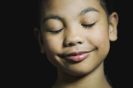islander: Pacific Islander girl smiling with eyes closed