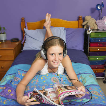 only girls: Teenaged girl reading in bedroom