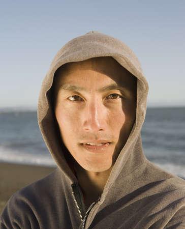 hooded sweatshirt: Asian man wearing hooded sweatshirt