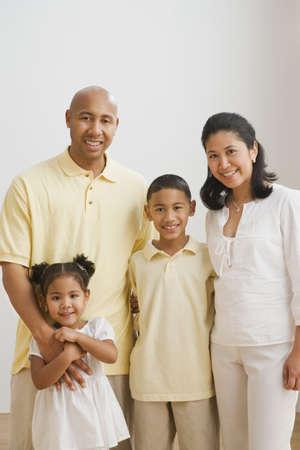 adoring: Portrait of multi-ethnic family hugging