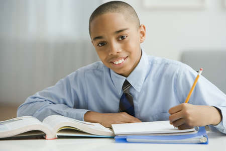 mixed race children: Portrait of African boy studying