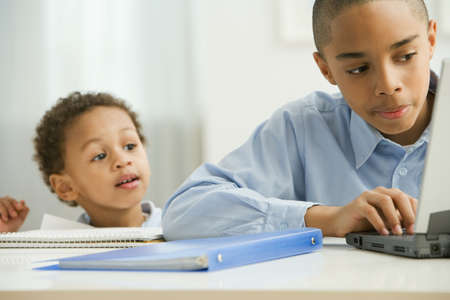 unruly: African boy watching brother study