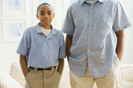 alike: Portrait of African boy next to father