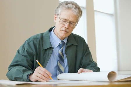 only mid adult women: Businessman writing on paperwork