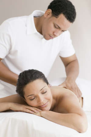 ninetys: Hispanic woman receiving massage