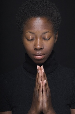 woman close up: Close up of African woman praying