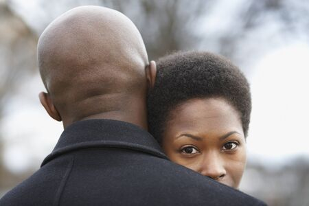 african american woman: Close up of African couple hugging