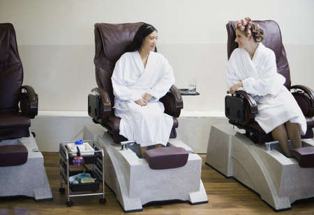 ostentatious: Two women receiving pedicures