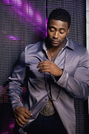 handsfree phone: Portrait of African man at nightclub