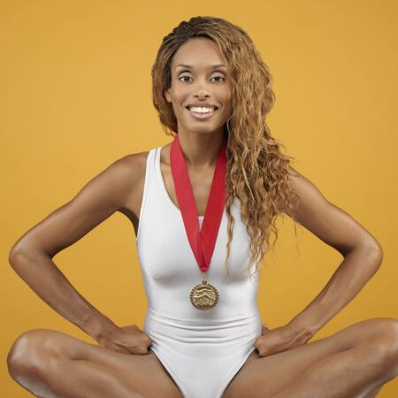 dressup: African woman wearing bathing suit and medal