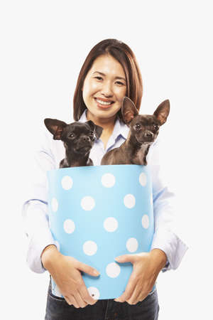 pampered pets: Portrait of Asian woman holding dogs