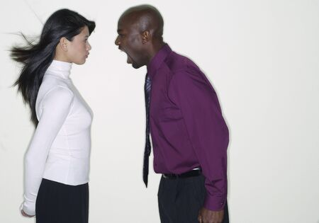 extending: African businessman yelling at coworker