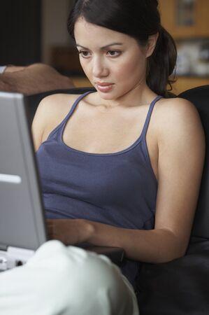 woman typing: Hispanic woman typing on laptop