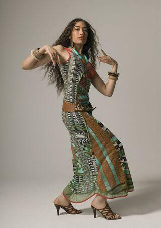 Studio shot of Asian woman dancing Stock Photo
