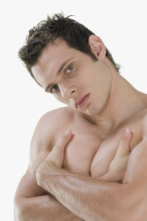 barechested: Bare-chested man with arms crossed