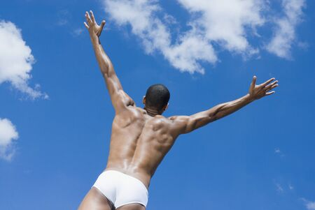 Semi-nude African man with arms outstretched