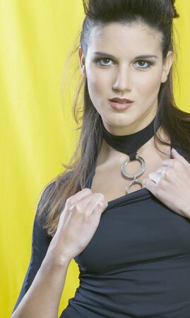 Hispanic woman pulling on collar