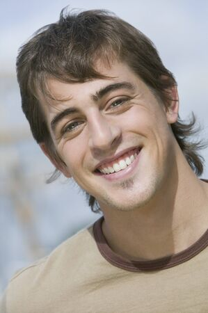 Close up of young man smiling Imagens