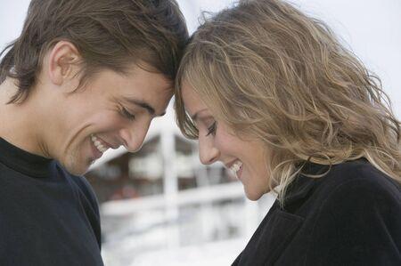 Young couple touching foreheads Banco de Imagens